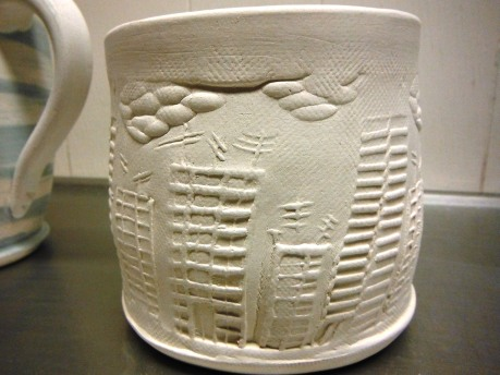 Make 21: I carved a cityscape rolling stamp, and tried it out here.
