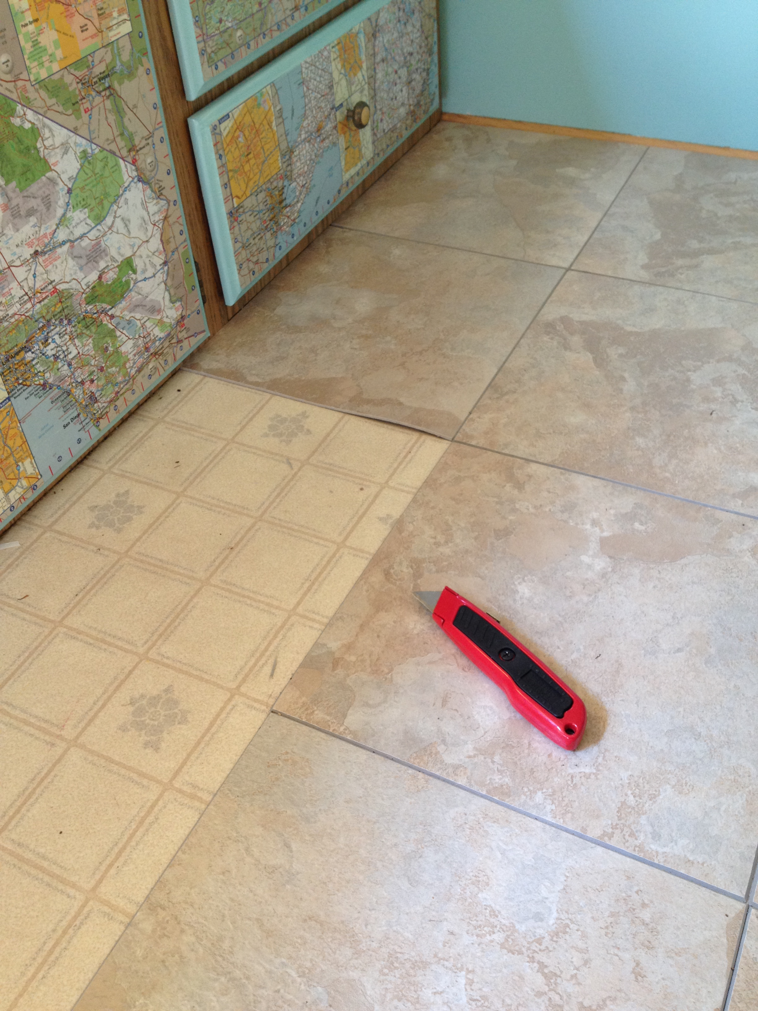 New floor for the pop up earthworks studio for Stick down linoleum tiles