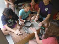 crushing the dry clay