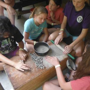 crushing the dry clay